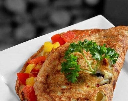 Rețetă de omletă vegetală cu roșii și porumb