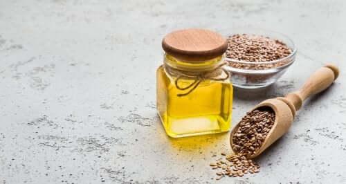Acidul linoleic conjugat într-un borcan lângă un bol cu grâu