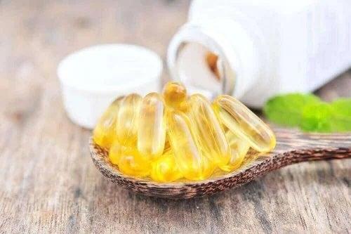 Lingură cu capsule de vitamina B6