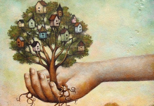 Mână care ține un copac